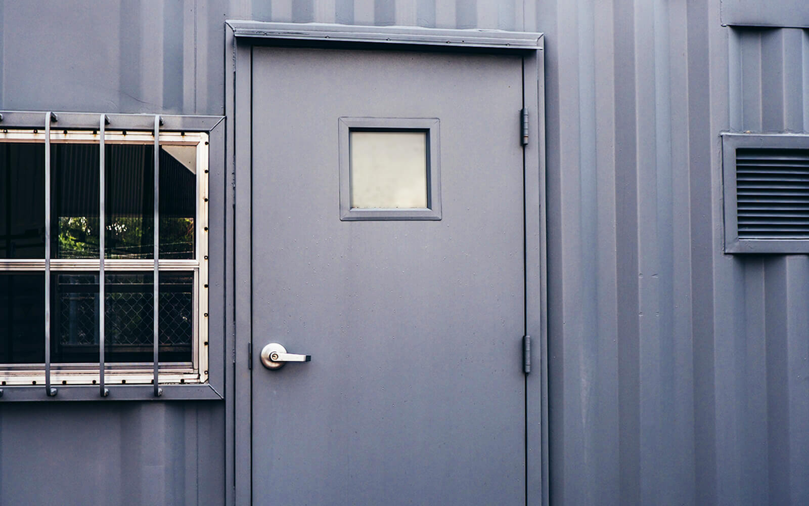 A American Container's Steel Man Door Old Style