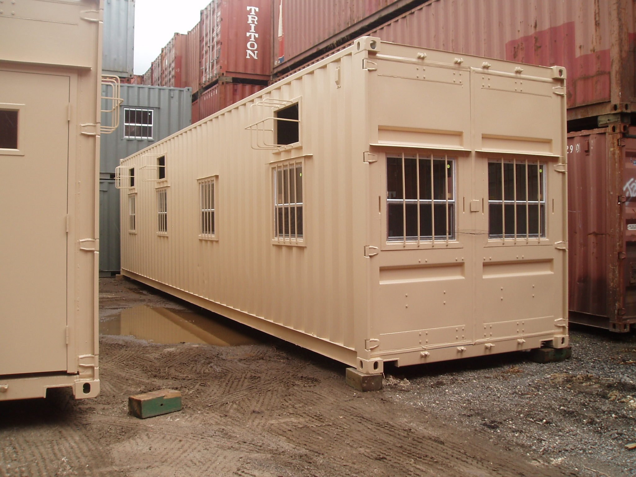 A American Container's buildout with multiple barred windows and A/Cs