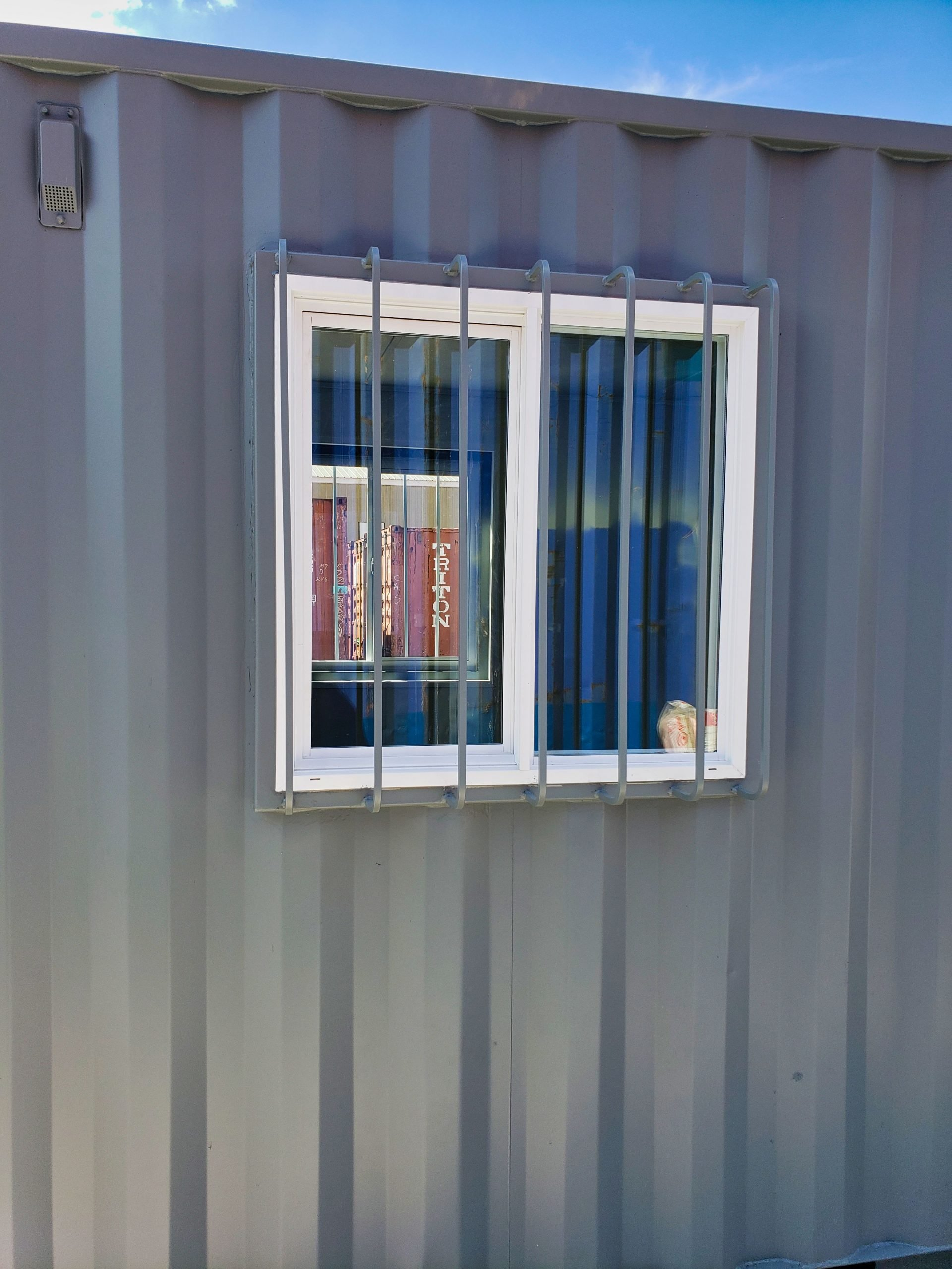 "A American Container's 35"" x 35"" window with bars"